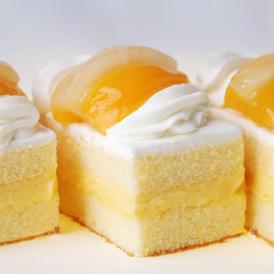 昔ながらのカスタード、上品な生クリーム、黄桃とパインの蜜漬けシンプルで優しい味わい超ロングランケーキ