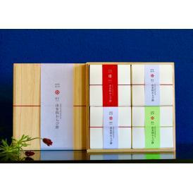 由布の天然水仕込み「由布院わらび餅」の4個入り桐箱詰合せです(きな粉×2個・抹茶きな粉×1個・黒糖き